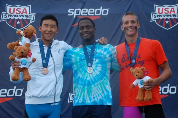 (L-R) Patrick Park (23.07), James Jones (23.04) and Caeleb Dressel (22.36) went 1-2-3 in the boys' 50 free at the 2014 U.S. Junior National Championships on Sunday.