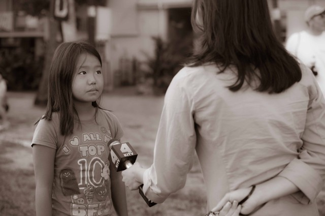Kayleigh Hanaoka, the youngest swimmer in the race (9) interviewed by local ABC reporter (photo: Mike Lewis, Ola Vista Photography)