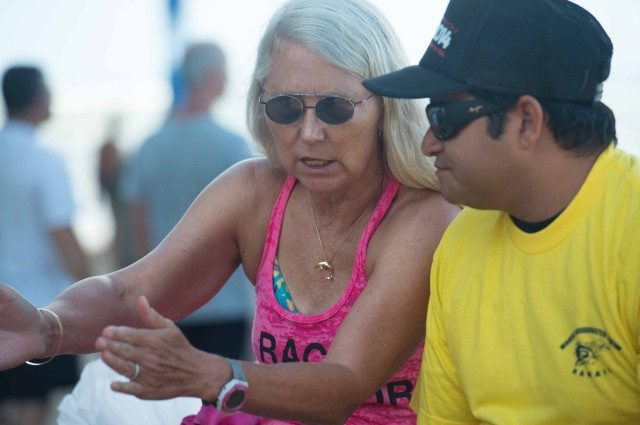 Kaia Hedlund reviews race protocol with officials (photo: Mike Lewis, Ola Vista Photography)