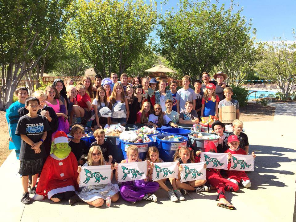 Coto Coyote Swim Team supports Trick or Treat so Kids Can Eat
