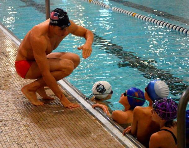 New Canaan, CT - Tim Phillips explaining a drill to swimmers