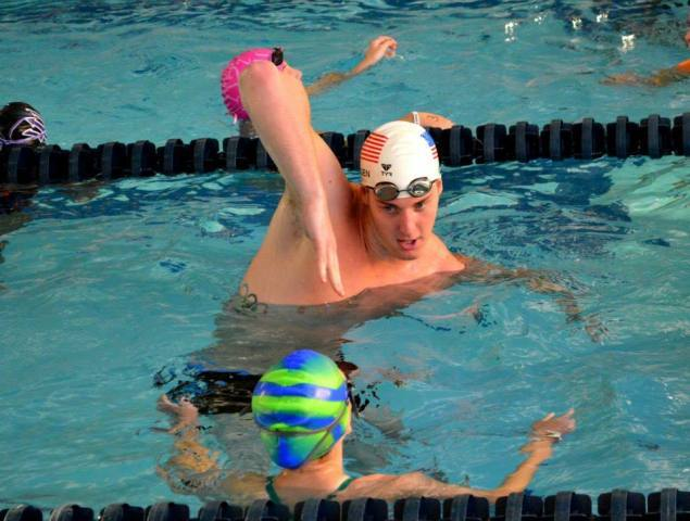 Pittsburgh, PA - Jimmy Feigen works on a high elbow with a swimmer - Fitter and Faster Swim Tour presented by SwimOutlet.com