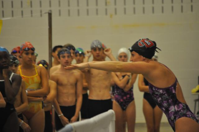 Pleasantville, NJ - Claire Donahue works with swimemrs on butterfly