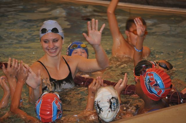 Pleasantville, NJ - Katie Meili gives high-fives to swimmers