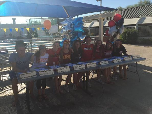 Scottsdale Aquatic Club seniors signing there NLI's at the pool this afternoo