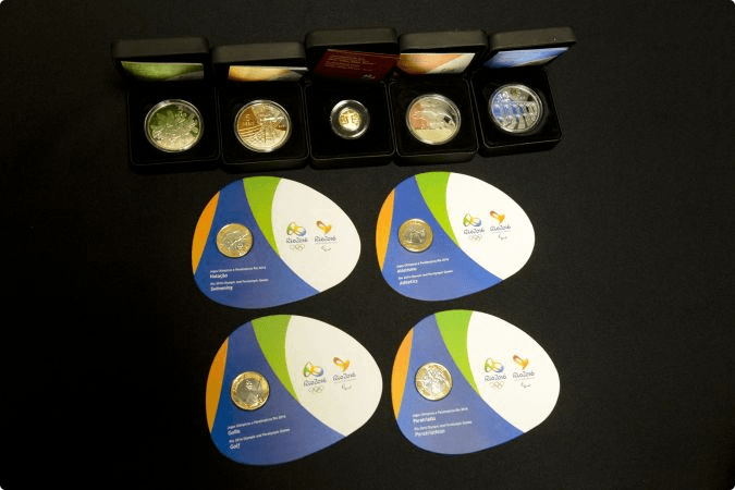 Swimming featured on first batch of Rio 2016 commemorative coins