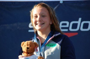 Allie Szekely on podium after winning 200bk at 2014 Summer Juniors. Photo: Anne Lepesant