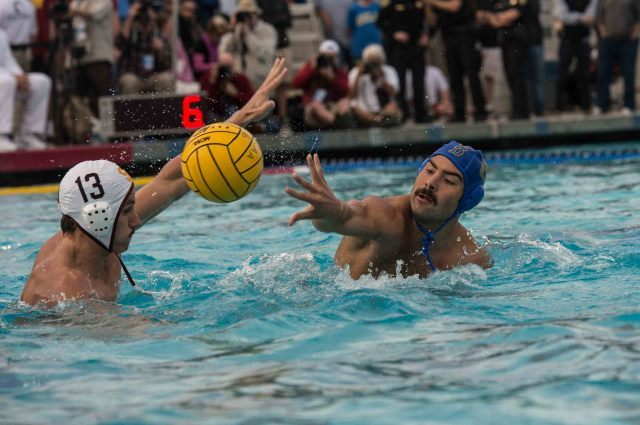 Anthony Daboub of UCLA shoots around USC's Marc Vonderweidt (photo: Mike Lewis, Ola Vista Photography)