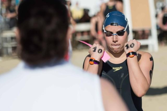 I like the intensity of Eva Fabian's face as she walked through the safety check at the open water swimming nationals.  Eva is one of the nicest people out there but when it comes time to race she knows how to get in the zone (photo: Mike Lewis, Ola Vista Photography)