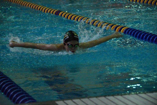 Eleanor McMeen, 11 of La Grange practices her butterfly during warm-ups prior to the Lyons Aquatics County Line Classic home meet Feb 14.
