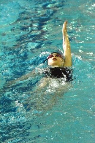 Samantha Chopp 10 of Lyons Aquatics is focused intently on her backstroke during warm-ups at the Lyons Aquatics County Line CLassic swim meet on Feb 14.