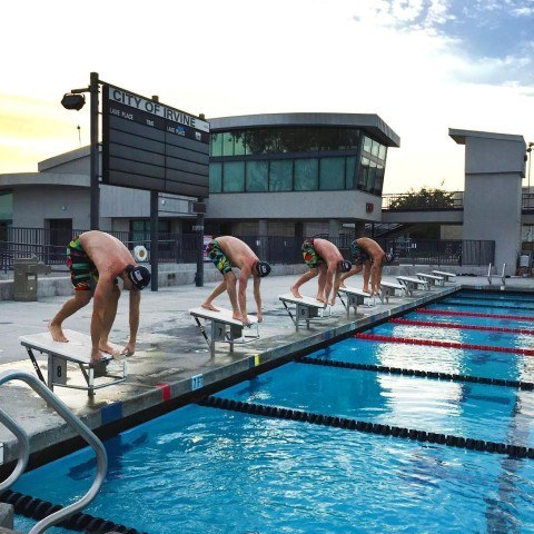 Nick Thoman, Michael McBroom, Josh Schneider and Matt Grevers sporting their TYR Avictors while taking their marks on the starting block.