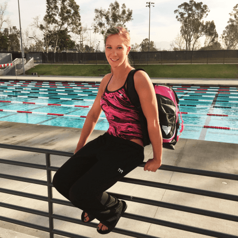 Ashley Twichell hanging by the pool in TYR Pink.