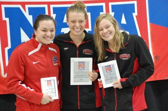 L to R: Charlotte Parent (Cumberlands), Christine Tixier (Biola),  and Lisa Tixier (Biola) all went under the meet record in the 200 IM at 2015 NAIA Nationals. Photo: Anne Lepesant