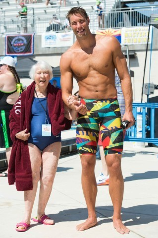 Matt Grever and Anne Dunivin (the oldest woman in the meet 98) shares some time with Olympic Champion Matt Grevers (Photo: Mike Lewis - Courtesy of U.S. Masters Swimming)
