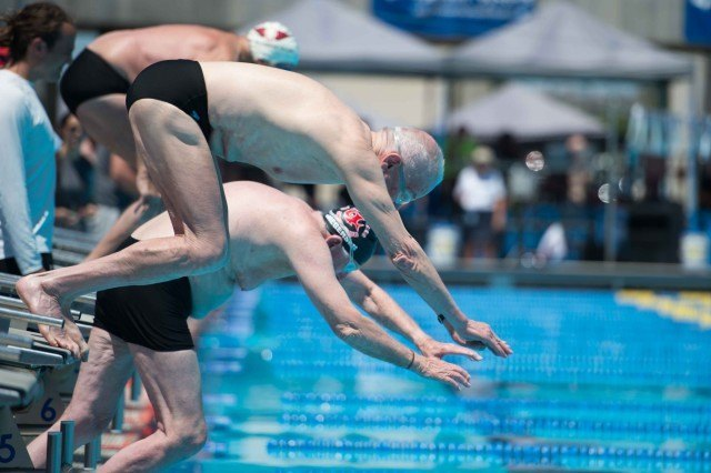 Arnold Reardon off the blocks in the 50 free.  (Photo: Mike Lewis - Courtesy of U.S. Masters Swimming)