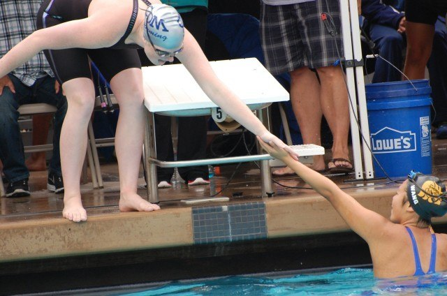CDM's Eva Merrell greets JSerra's Sonia Wang at CIFSS D1 in 100 back. Photo: Anne Lepesant