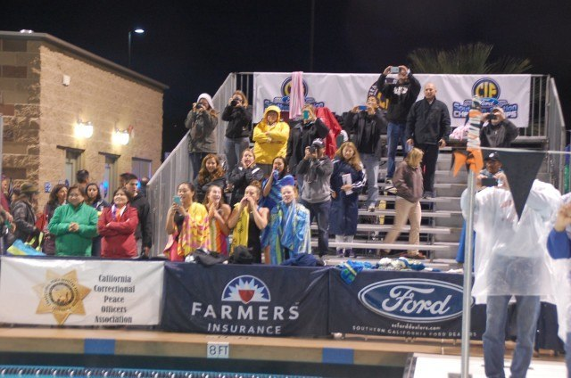 The crowd braved the rain at CIFSS Division III finals. Photo: Anne Lepesant