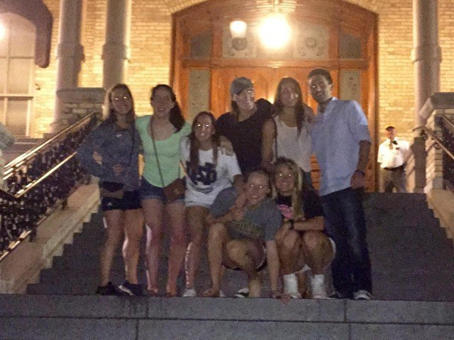 Emma Reaney with her friends on the stairs of the Golden Dome. Legend has it that if you climb the stairs before you're completely done, you won't graduate.