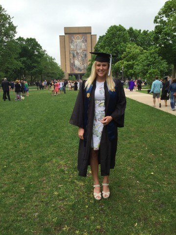 """Emma in front of the famous """"Touch Down Jesus"""" on Notre Dame's campus."""