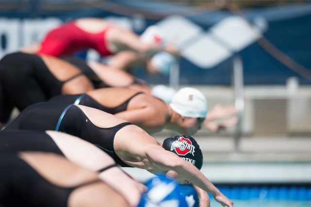 Aliena Schmidtke off the blocks in the prelims of the 100 fly (photo: Mike Lewis, Ola Vista Photography)