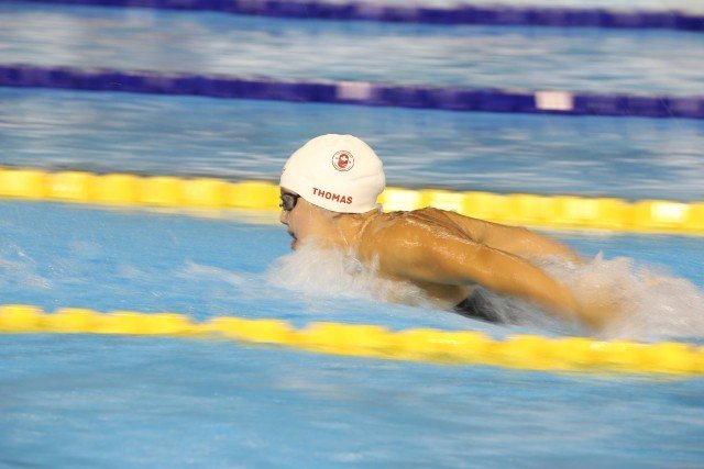 Noemie Thomas swims the fly leg on the 4x100m medley relay at Toronto 2015