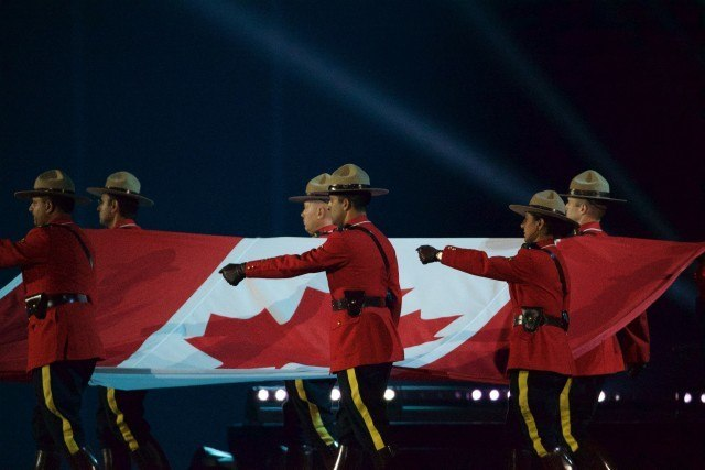 Toronto -- RCMP carry the Canadian flag into the opening ceremonies of the Toronto 2015 Pan Am games at the Pan Am Dome. July 10, 2015.