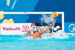 U.S.A. men's water polo team Captain Tony Azevedo returns a teammates pass as the team competes against Italy at the 2015 FINA World Championships held in Kazan, Russia.