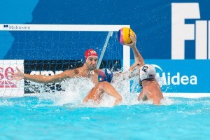 John Mann of the U.S.A scores against Italy in the final game of the water polo preliminary competition at the 2015 FINA World Championships held in Kazan, Russia.