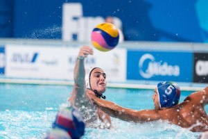 Josh Samuels scores team USA's fourth goal against Italy in the final game of the preliminary round of water polo competition at the 2015 FINA World Championships in Kazan, Russia.