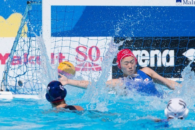 Margaret Steffens of the USA women's water polo team put's her team up 2-0 against the Japanese team in preliminary round action at the 2015 FINA World Championships held in Kazan, Russia. (courtesy of Tim Binning, theswimpictures.com)