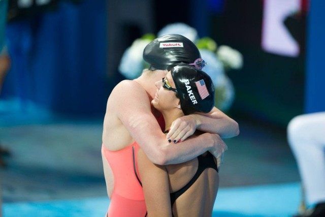 Missy Franklin gives Kathleen Baker a hug at the start of the women's 100 backstoke final on Day 3 of 2015 World Championships. (courtesy of Tim Binning, theswimpictures.com)