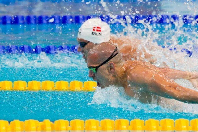 Laszlo CSEH posts top time in the world this year 1.53.71 in the mens 200 butterfly prelims, (courtesy of Tim Binning, theswimpictures.com)