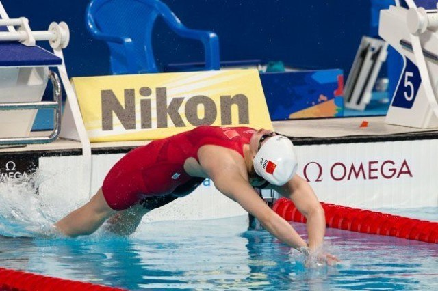 Fu Yuanhui, CHN, led the women's 50m back qualifiers with her semi-final time of 27.18. Day 4 of 2015 World Championships  (courtesy of Tim Binning, theswimpictures.com)
