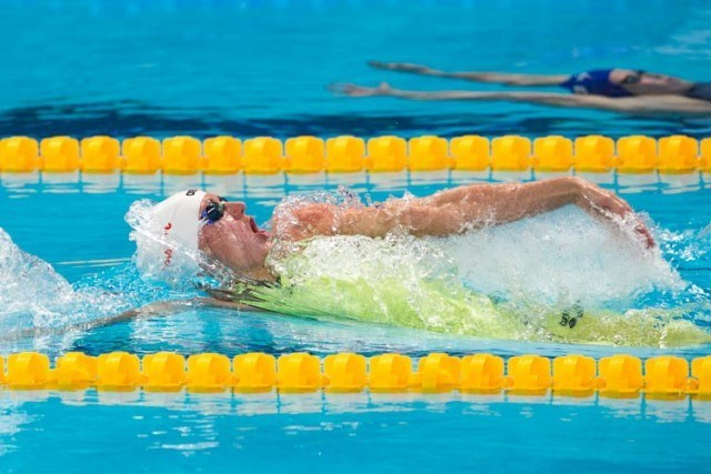 Katinka HOSSU smashing 100m backstroke heat of 58.78, photo courtesy of Tim Binning theswimpictures.com
