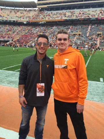 Taylor Abbott (right) with Tennessee distance coach Tyler Fenwick.