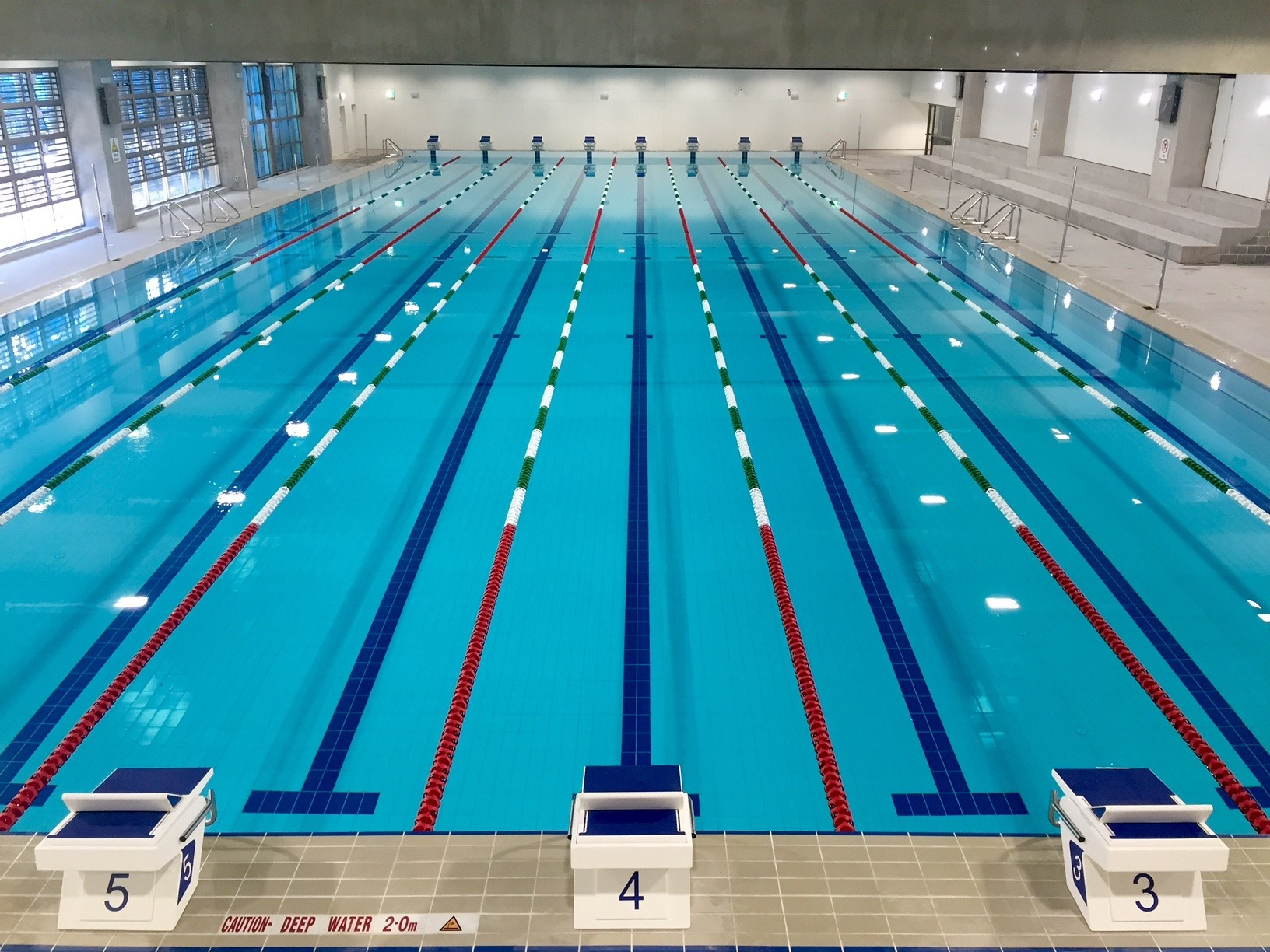 Cutting edge 50m pool opens at trinity grammar australia for Swimming pool design jobs