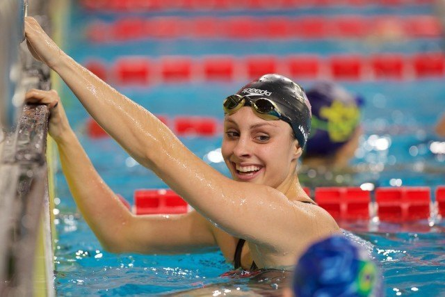Katie Meili is all smiles after breaking the 100m breaststroke meet record, courtesy of Domeyko Photography