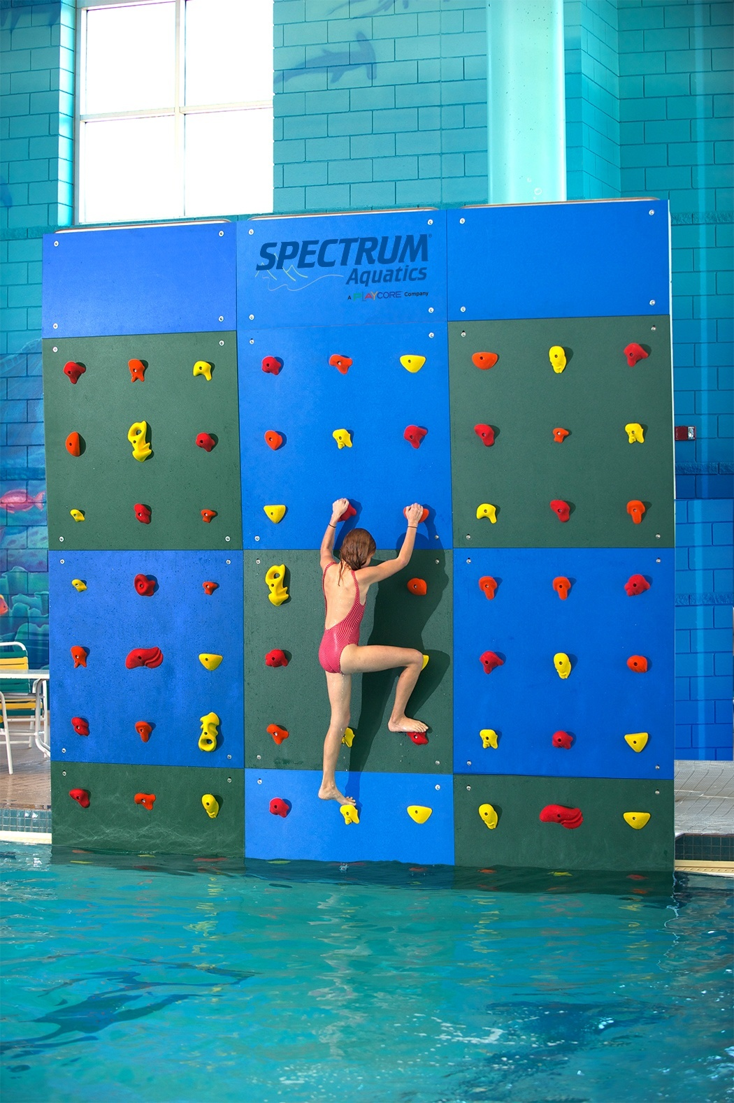 Cross Train With A Pool Climbing Wall