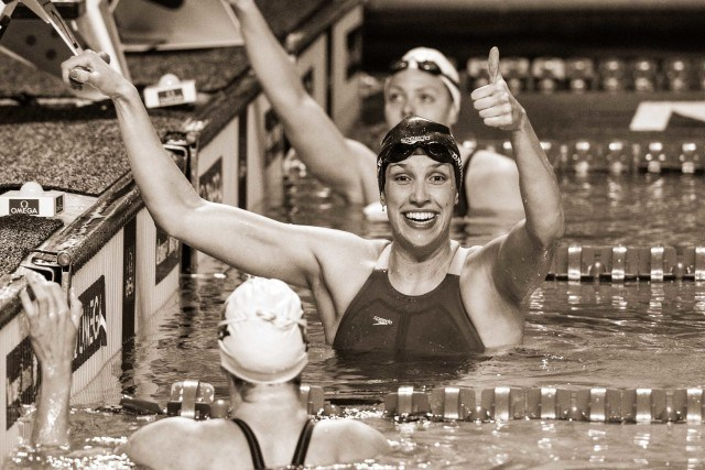 Courtney Bartholomew takes the win and the American record in the 100 backstroke (photo: Mike Lewis)