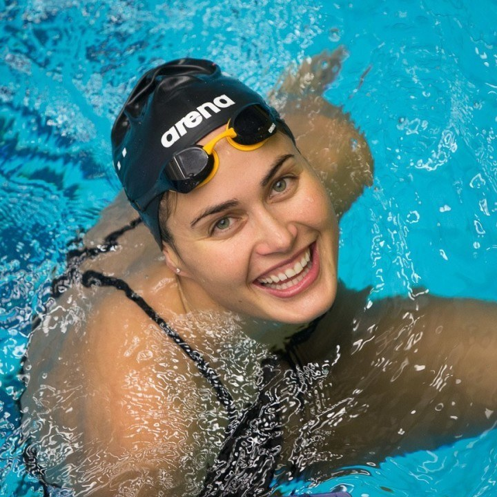 Which Comes First, the Smile or the Fast Swim?