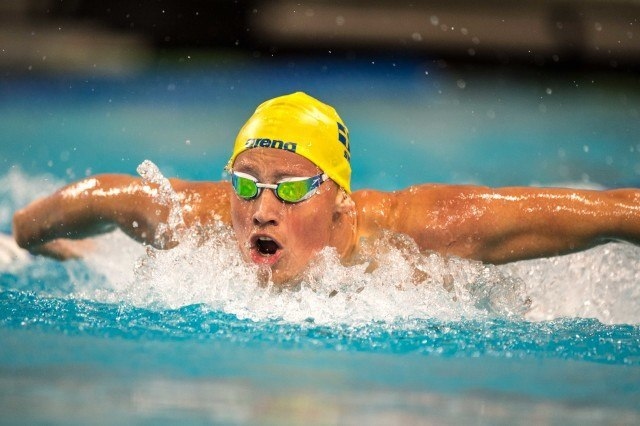 Jesper Bjork of Sweeden in the prelims of the 200 fly at the pro swim series in Austin Texas (photo: Mike Lewis)