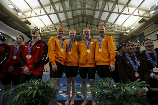 Faith Johnson of the Tennessee Volunteers, Harper Bruens of the Tennessee Volunteers, Kira Toussaint of the Tennessee Volunteers and Madeline Banic of the Tennessee Volunteers during day 2 of SEC Swimming and Diving Championships at the University of Missouri Mizzou Aquatic Center in Columbia, MO. Photo By Craig Bisacre/Tennessee Athletics