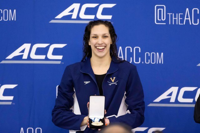 University of Virginia Senior Courtney Bartholomew is awarded the gold medal after winning the 200 individual medley in 1:55.63 at the 2016 ACC Women's Swimming & Diving Championships held at the Greensboro Aquatic Center in Greensboro, NC from February 17 to February 20. (Photo Courtesy: Tim Binning/TheSwimPictures.com)