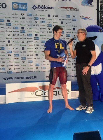 Georges Kiehl interviews Ben Proud after the50 m fly victory ceremony.
