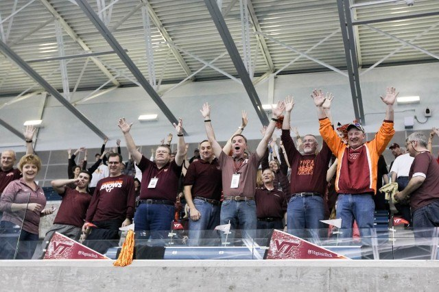 Virginia Tech parents enthusiastically cheer during the t-shirt toss before the start of finals on day 3 of the 2016 ACC Men's Swimming and Diving Championships. (Courtesy: Tim Binning/TheSwimPictures.com)