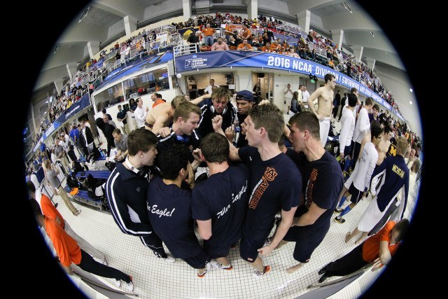 The Auburn Tigers circling up before the night's races. Photo Credits: Tim Binning/TheSwimPictures.com