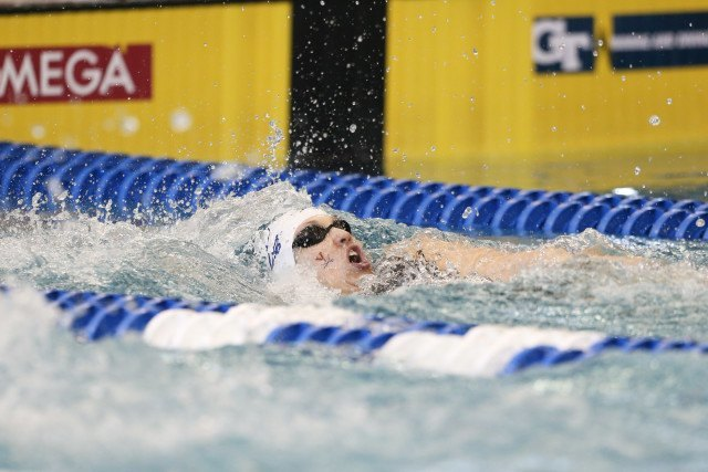 Top-seed, Courtney Bartholomew, coming to the finish in the 100 back. Photo Credits: Tim Binning/TheSwimPictures.com