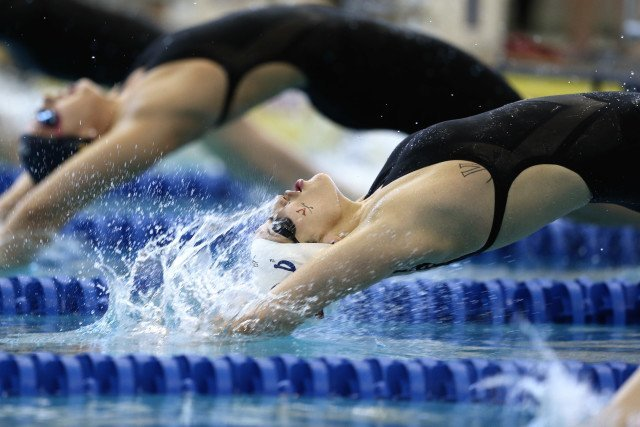 Courtney Bartholomew's backstroke entry, caught in the moment. Photo Credits: Tim Binning/TheSwimPictures.com