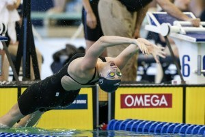 Amy Bilquist on her backstroke take-off during the 400 Medley Relay/Tim Binning/TheSwimPictures.com